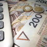 Polish finances - two hundred zloty banknotes and a calculator